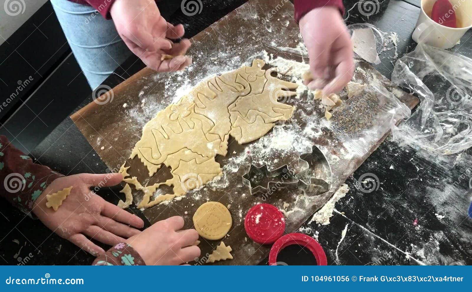 Childrens Hands Making Unicorn Shaped Christmas Cookies