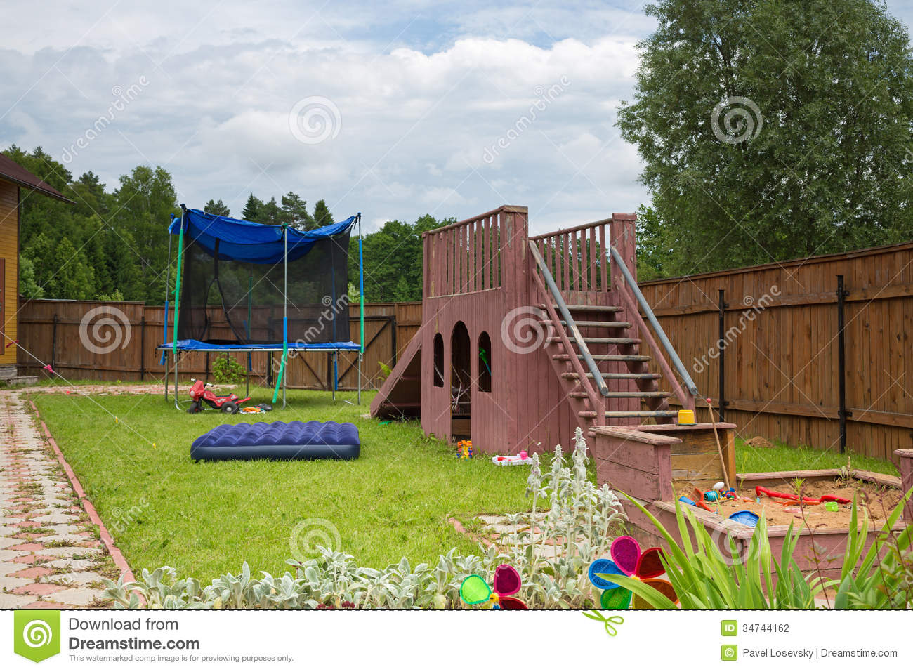 childrens slide trampoline and sandbox on the playground stock