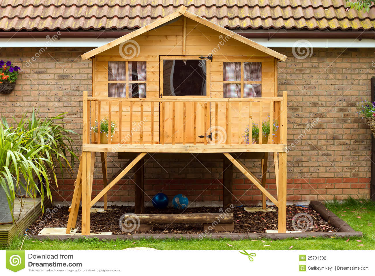 childrens wooden treehouse in the garden stock photo