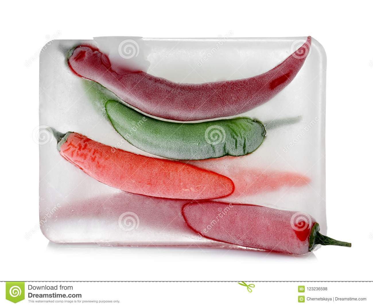 Chili peppers in ice cube on white backgroun