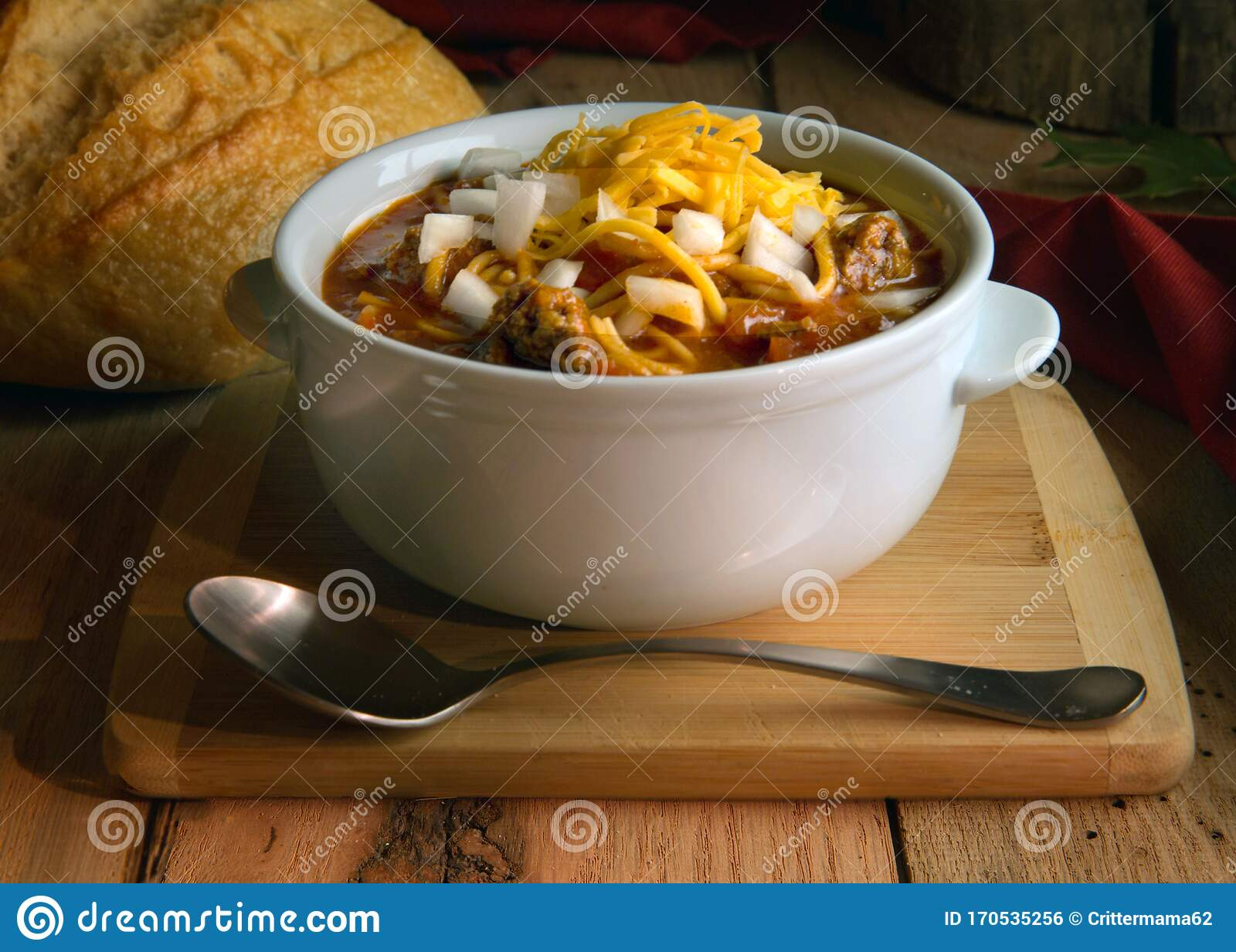 Chili In White Crock With Onions And Cheddar Cheese On Rustic Wood Table Stock Photo Image Of White Food 170535256