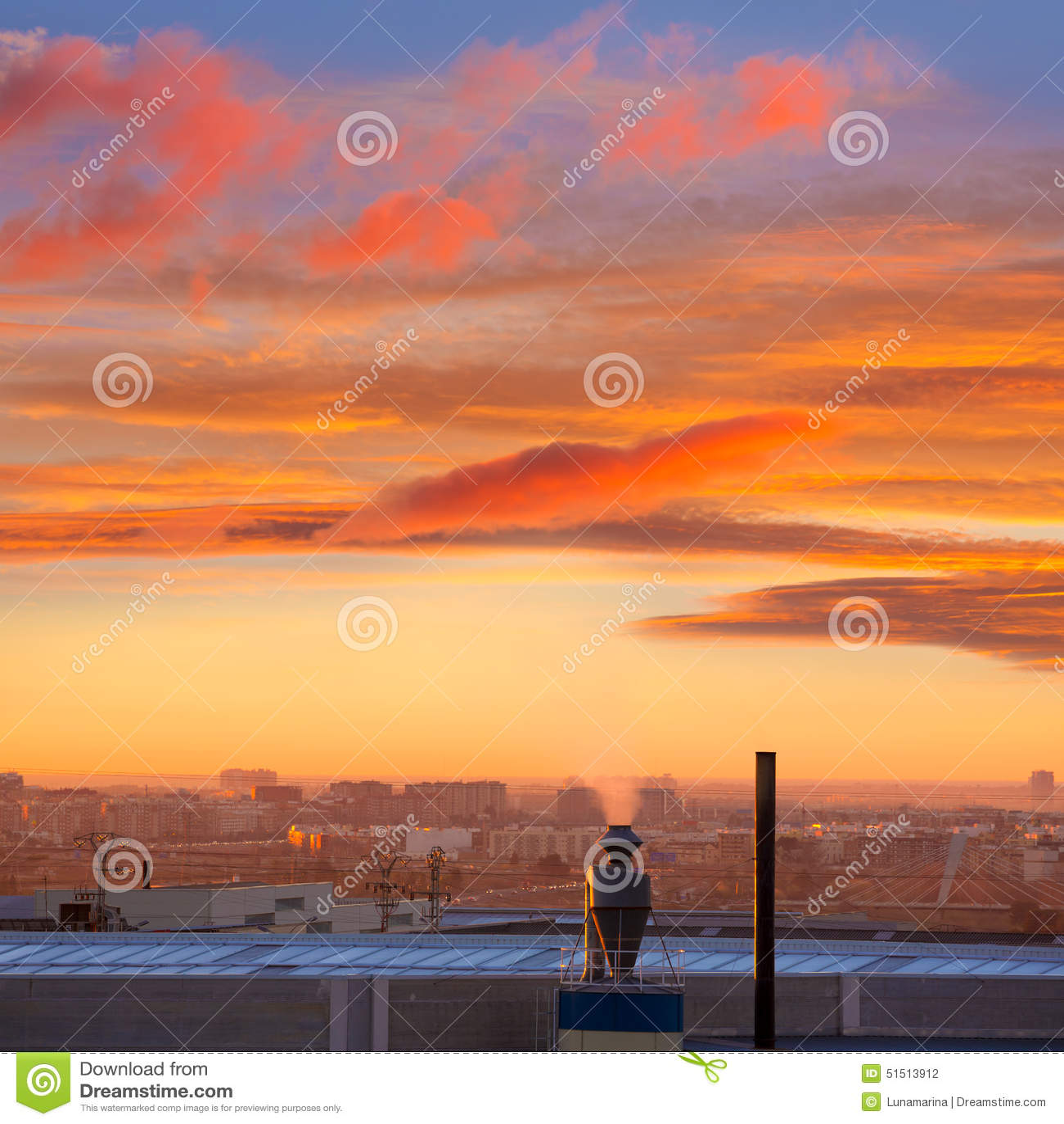 Chimenea en la salida del sol en Paterna Valencia Spain