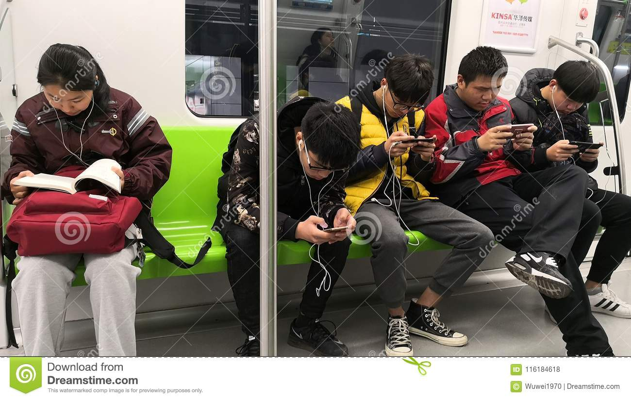 Students on the subway editorial stock photo  Image of games