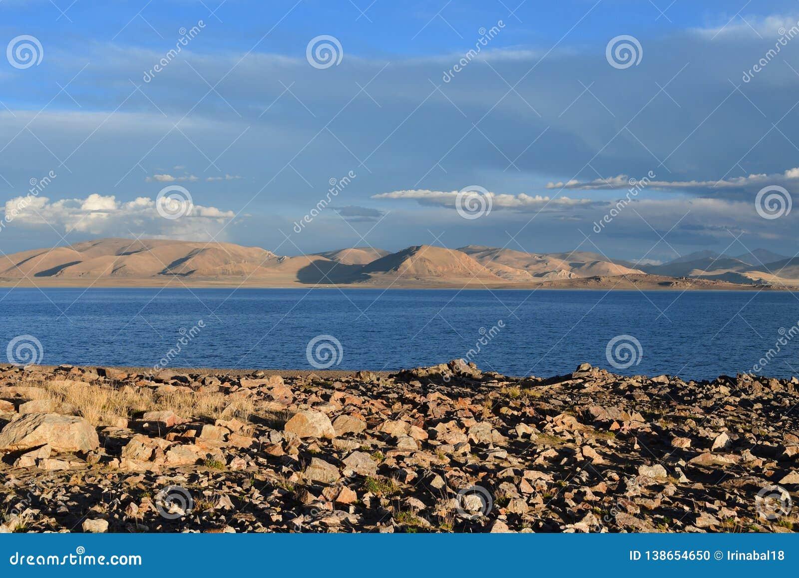 China. Great lakes of Tibet. Lake Teri Tashi Namtso in the setting sun in summer