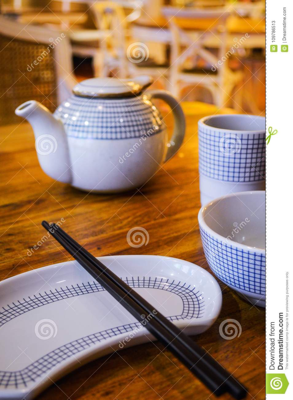China local Restaurant Table Setting with Chopsticks, Plate,Teapot and Bowl.
