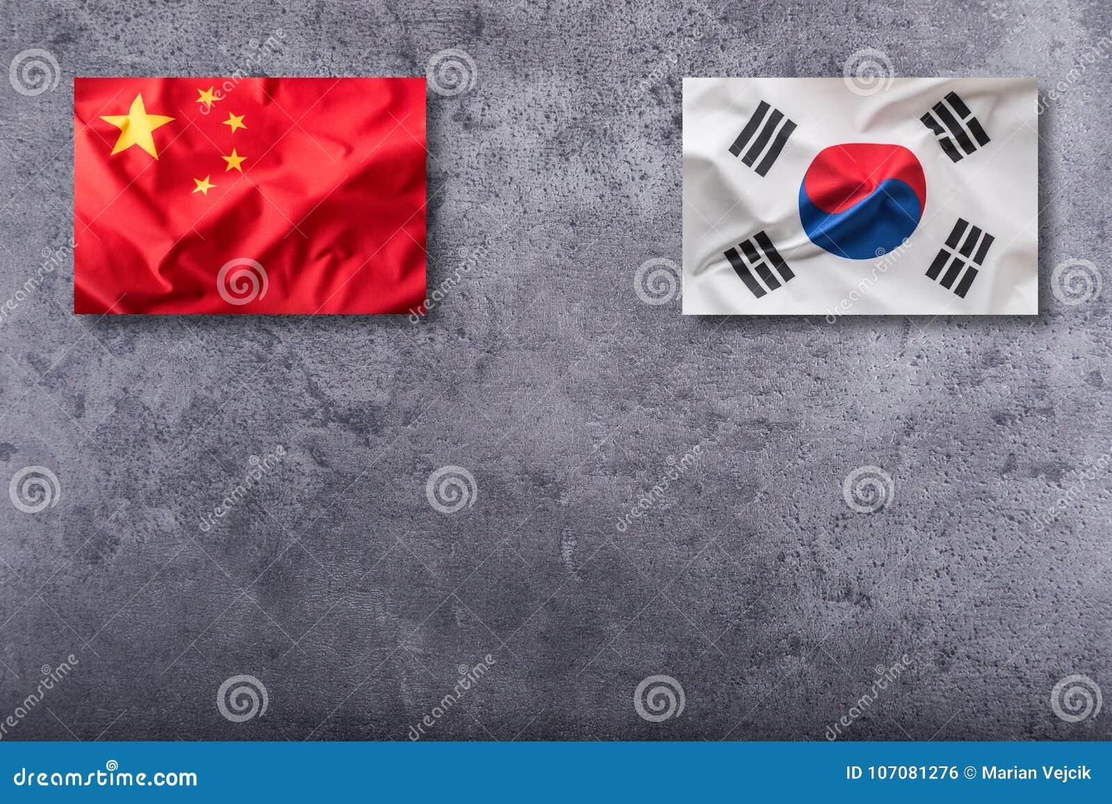 China and South korea flag on concrete background