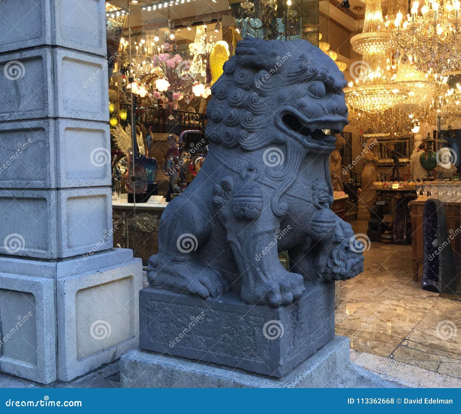 Chinatown`s Dragon Gate, guardian female lion, 2.