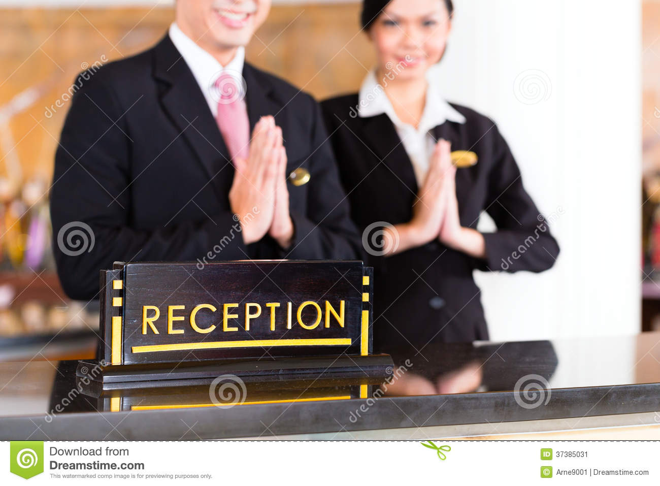 Chinese Asian Reception Team At Hotel Front Desk Stock