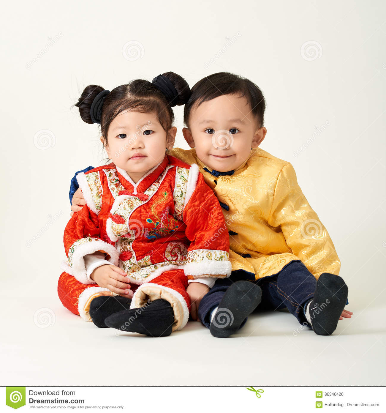 ee3b13aec Chinese Baby Boy And Girl In Traditional Chinese New Year Outfit ...