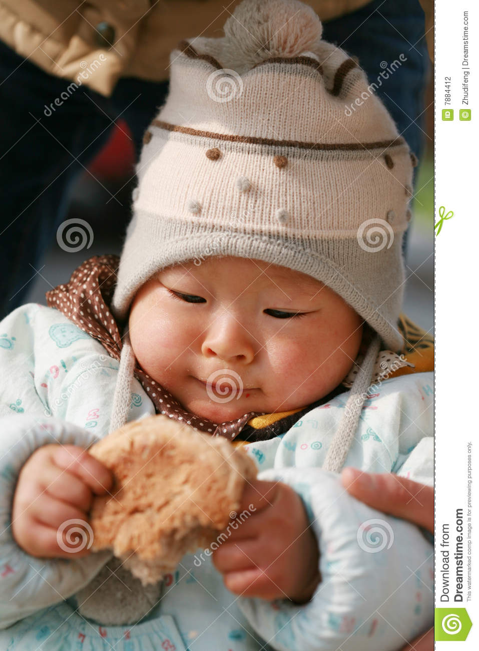 Chinese Baby Eating Bread Stock Photography - Image: 7884412