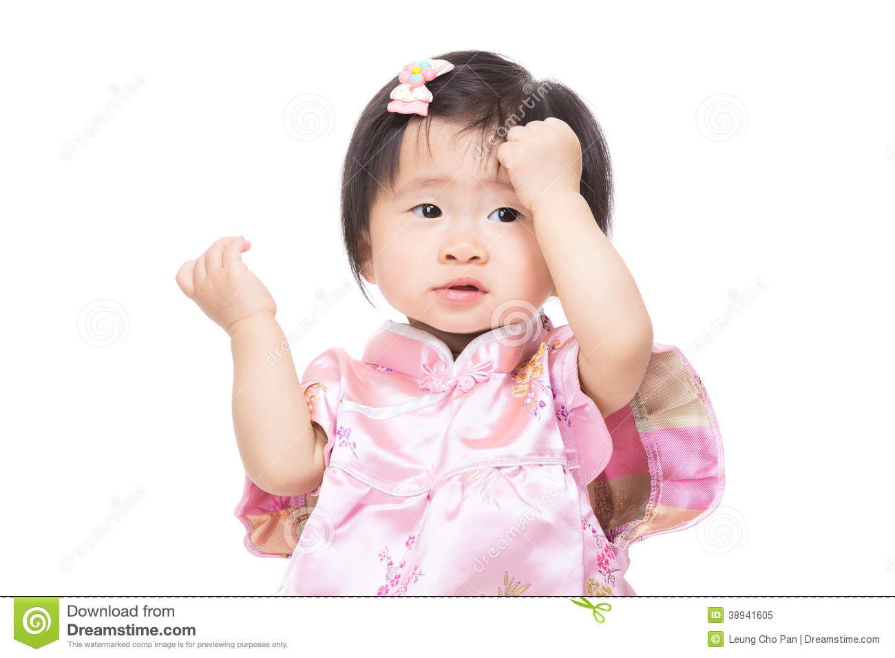 Chinese baby girl touch her head