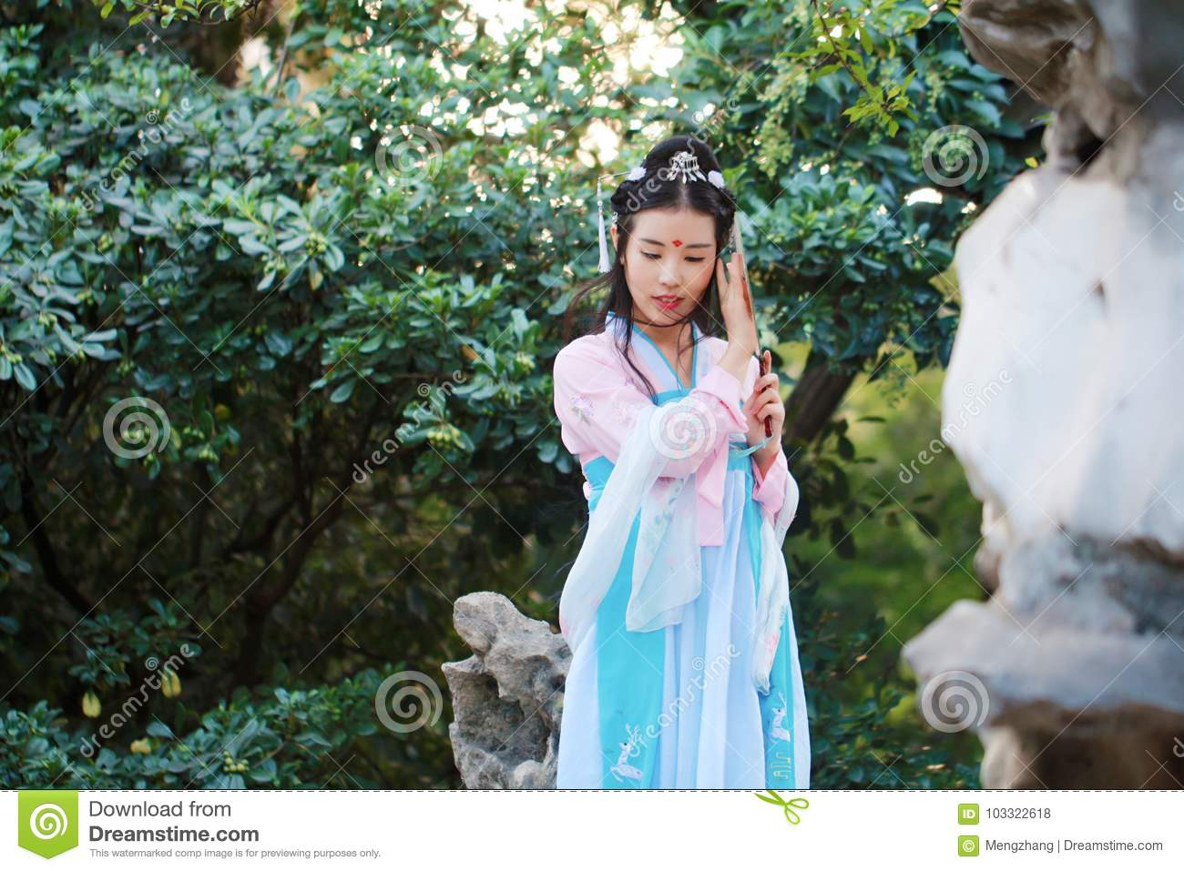 Asian Chinese woman in traditional ancient drama costume hanfu cosplay