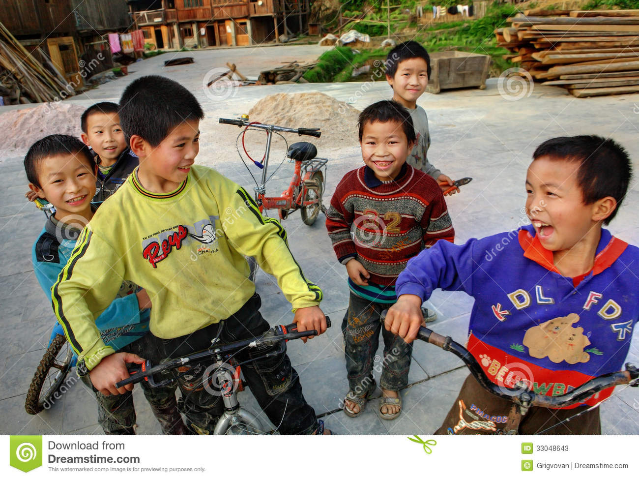 Chinese Boys Riding Bikes On The Ethnic Village Peoples Editorial  # Bois En Chaene