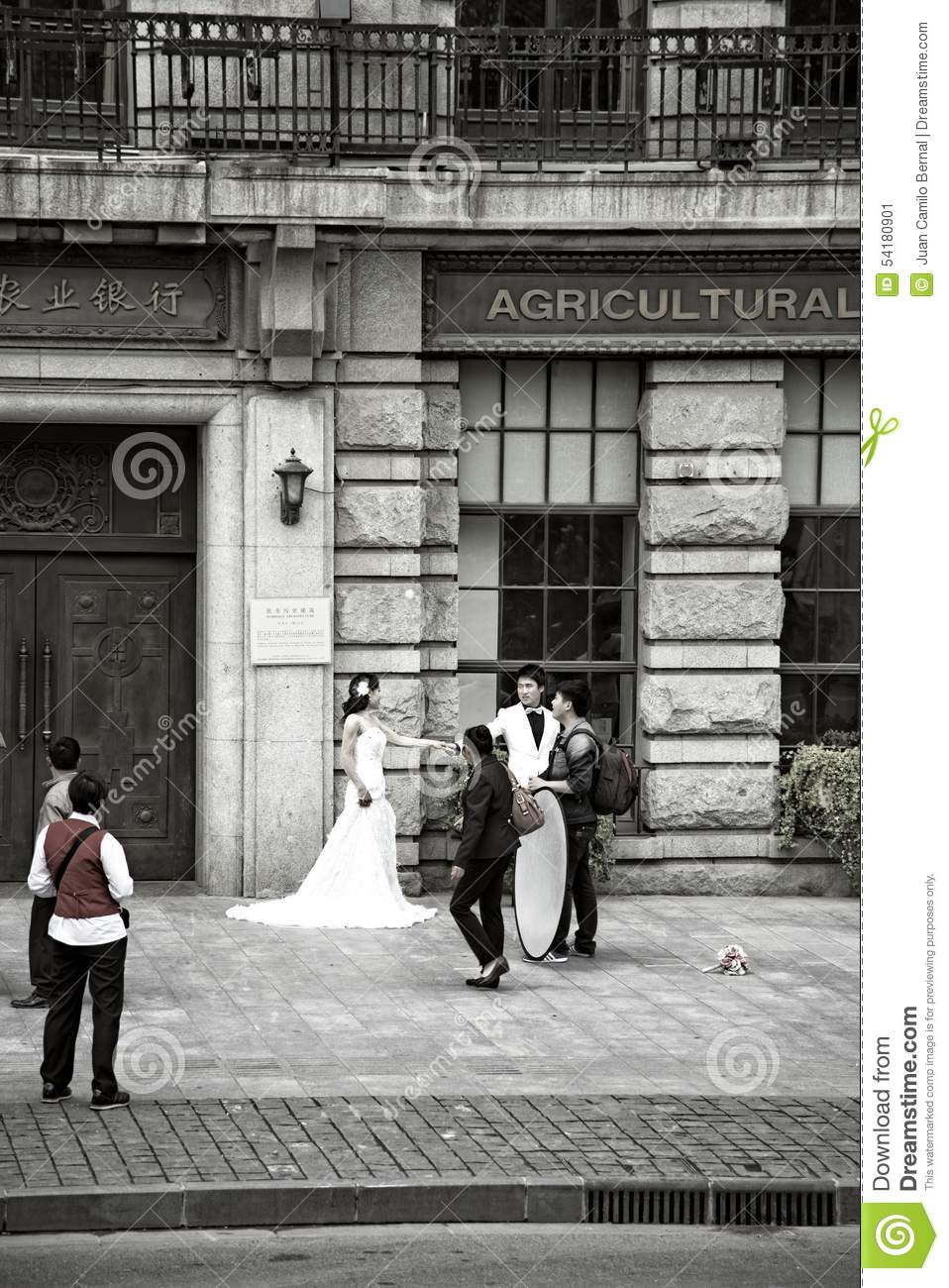 Chinese Bride And Groom On The Street Editorial Photo