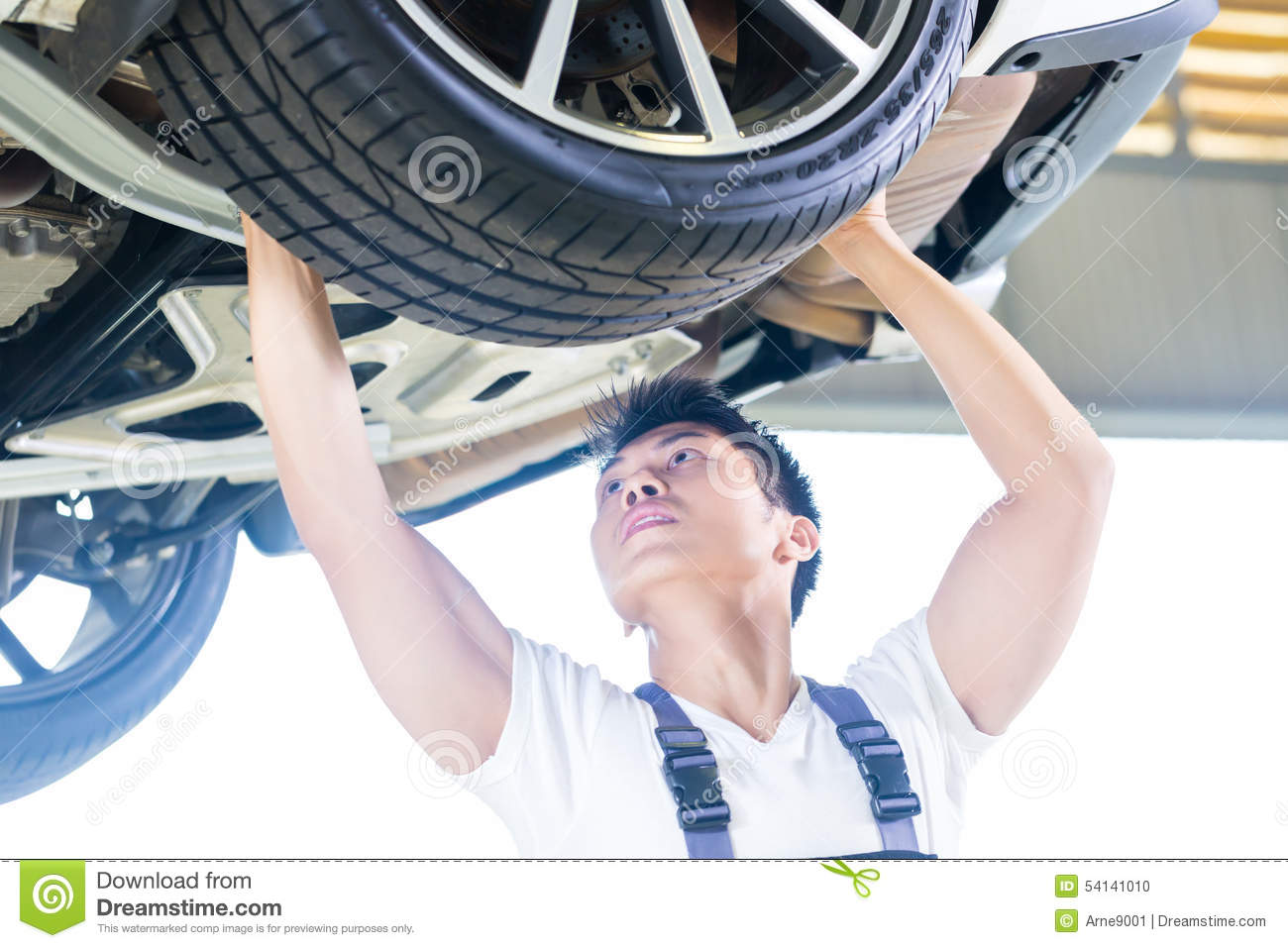 chinese car mechanic changing auto tire stock photo. Black Bedroom Furniture Sets. Home Design Ideas