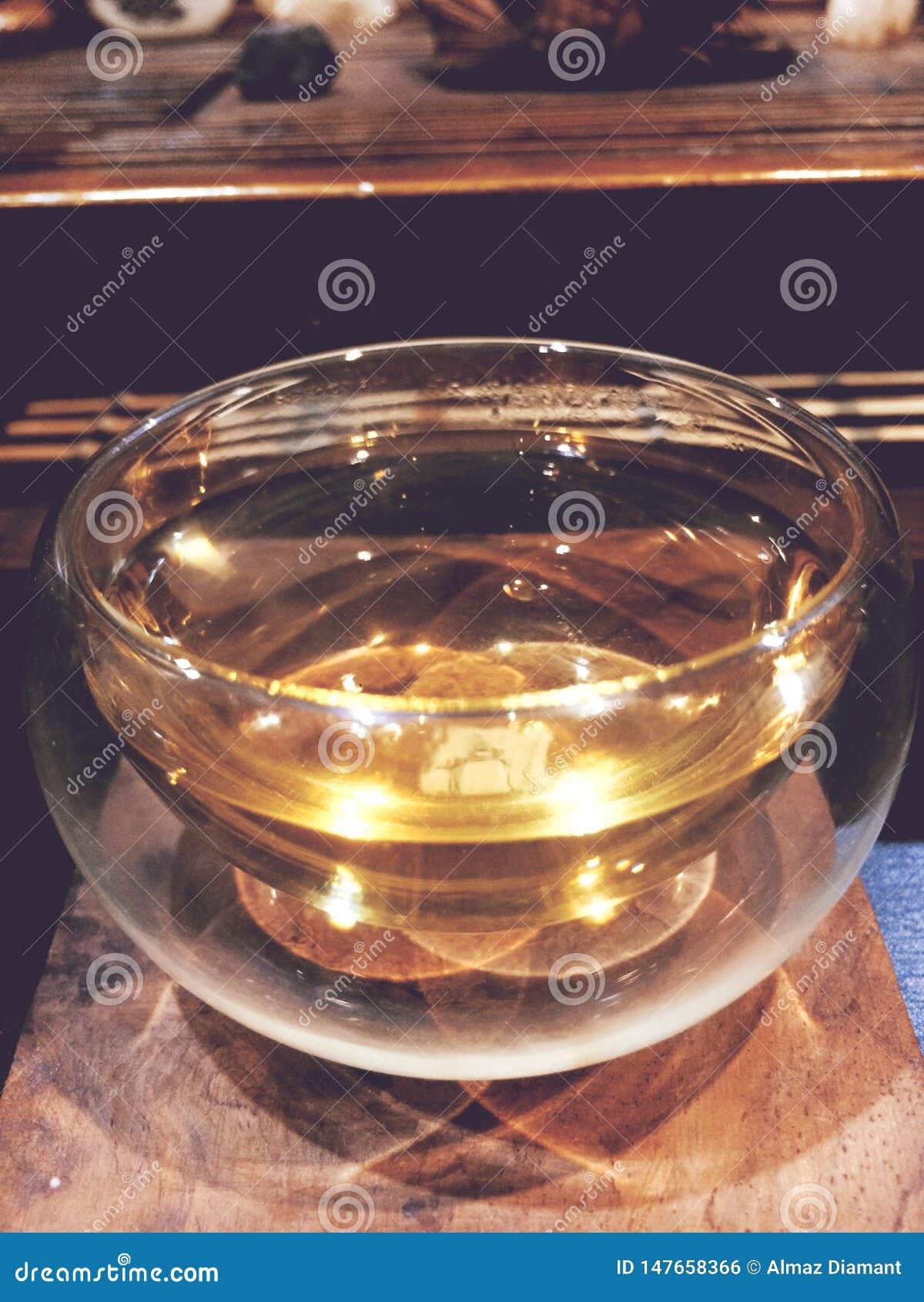 The tea ceremony, light small glass cup of tea