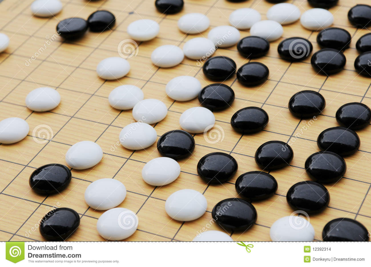 Chinese chess round black and white pieces on square wood board with ...