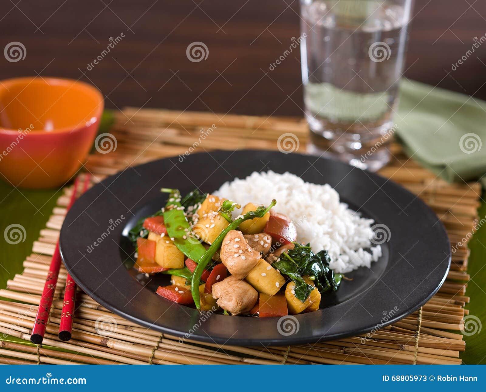 Chinese chicken and vegetable teriyaki stir fry served on dark ceramic ...