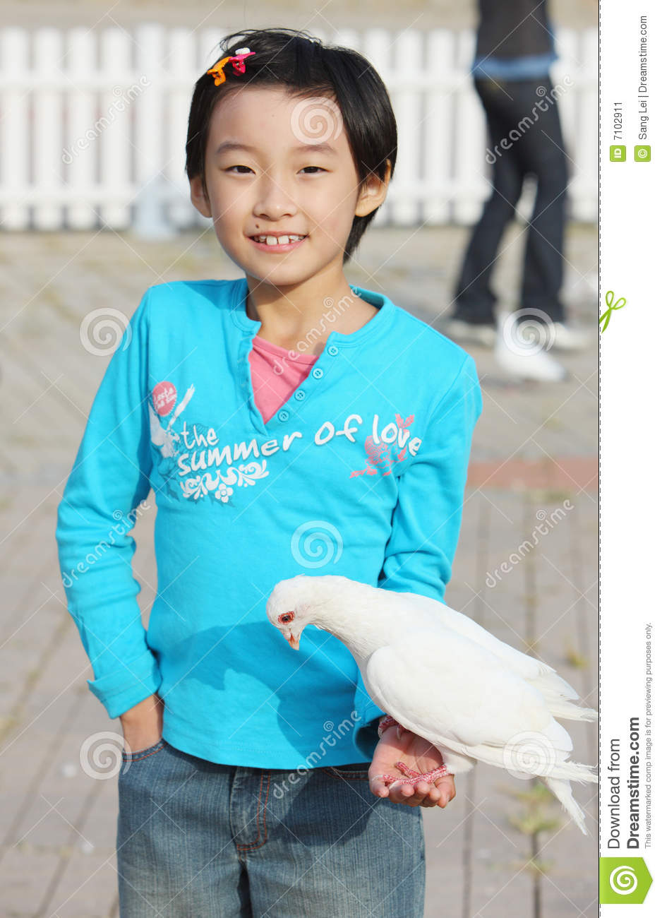 Chinese child with pigeon stock image. Image of daughter ...