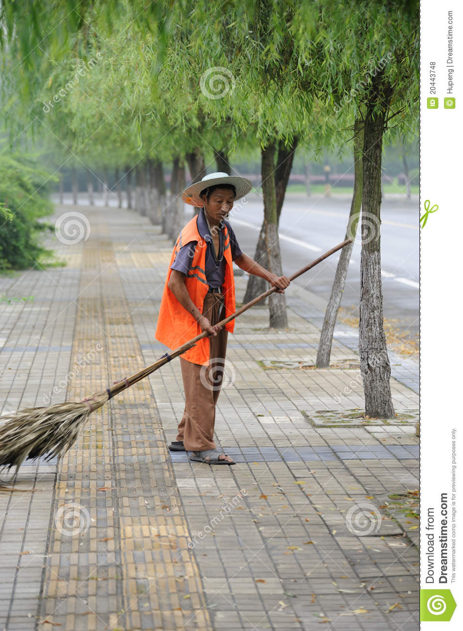 A Chinese Cleaner Is Sweeping Street Editorial Stock Photo