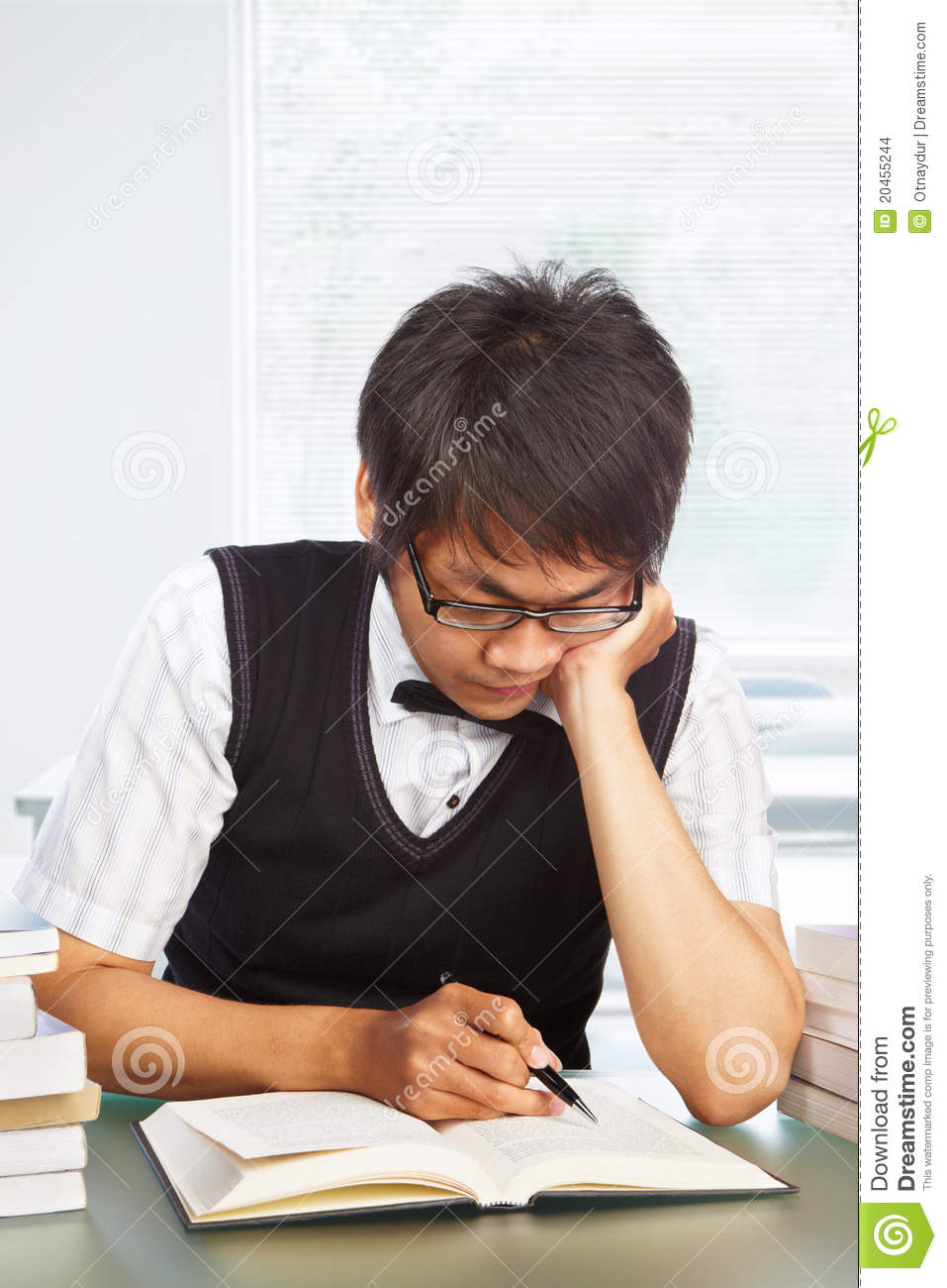 chinese college male student studying stock photo