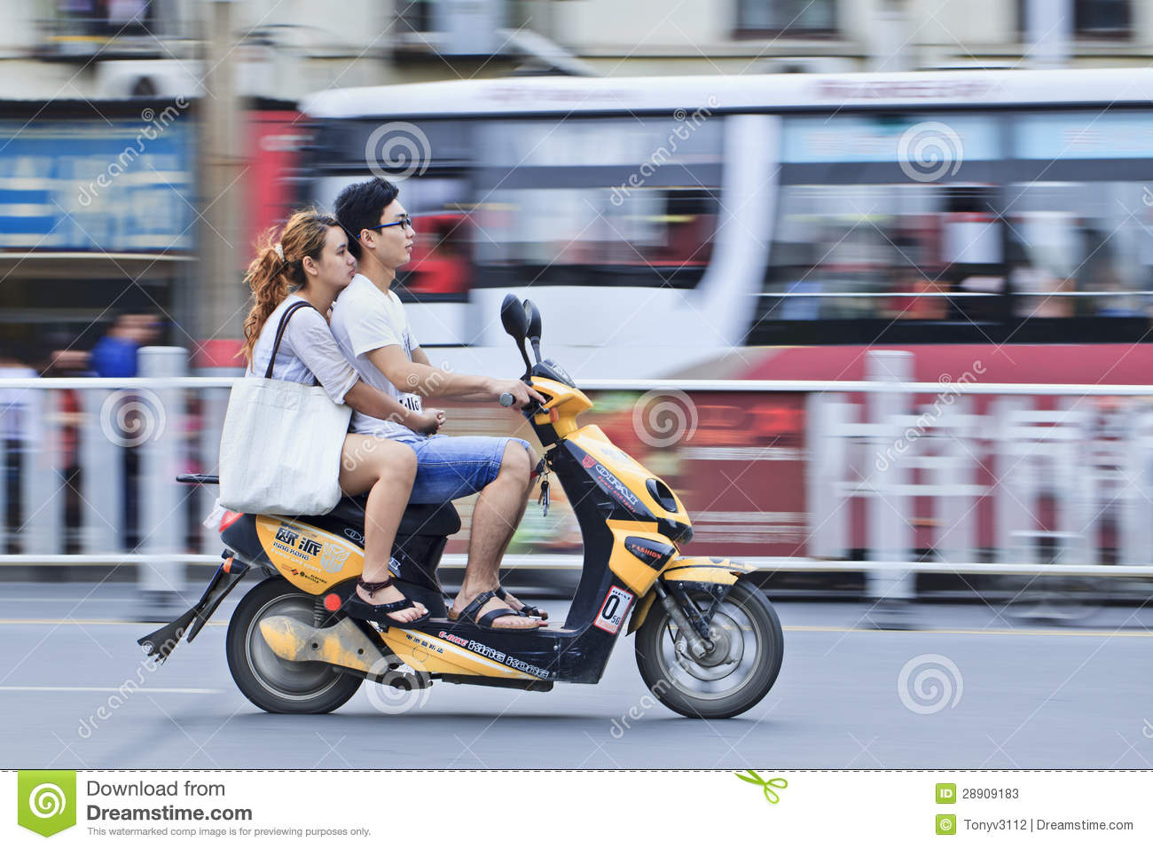 chinese couple on an electric bike o editorial stock photo. Black Bedroom Furniture Sets. Home Design Ideas