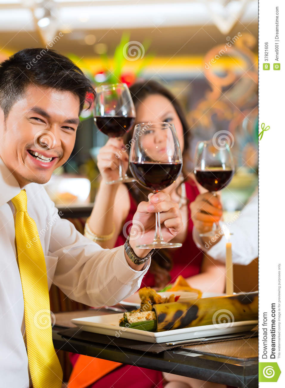 ... during dinner or lunch in a elegant restaurant with red wine glasses