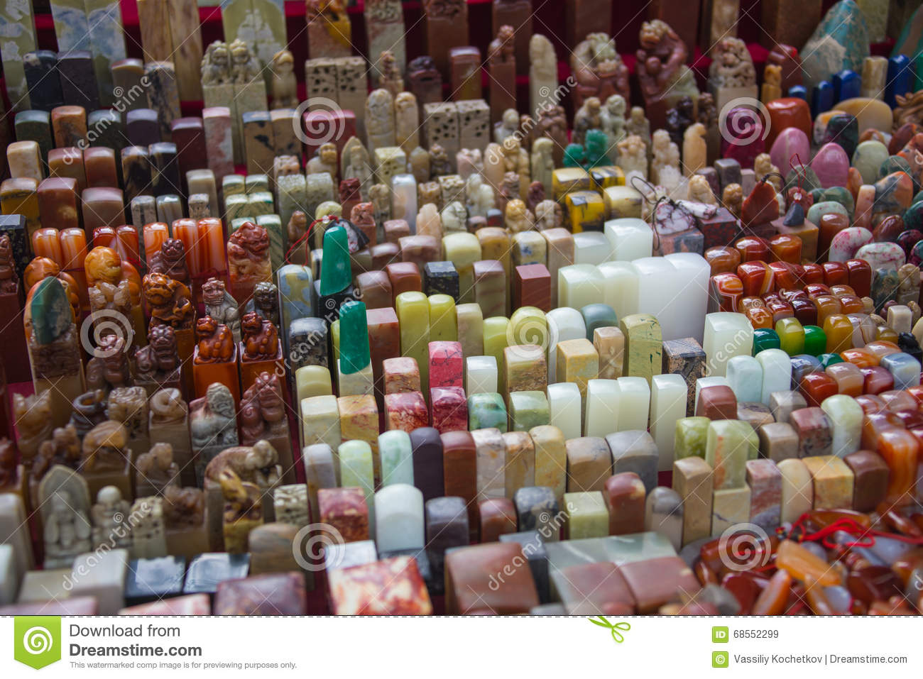 Chinese craftsman carving a stone seal stock photo image
