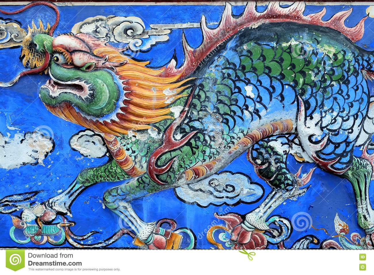 Chinese dragon beautiful ancient art on a wall stock