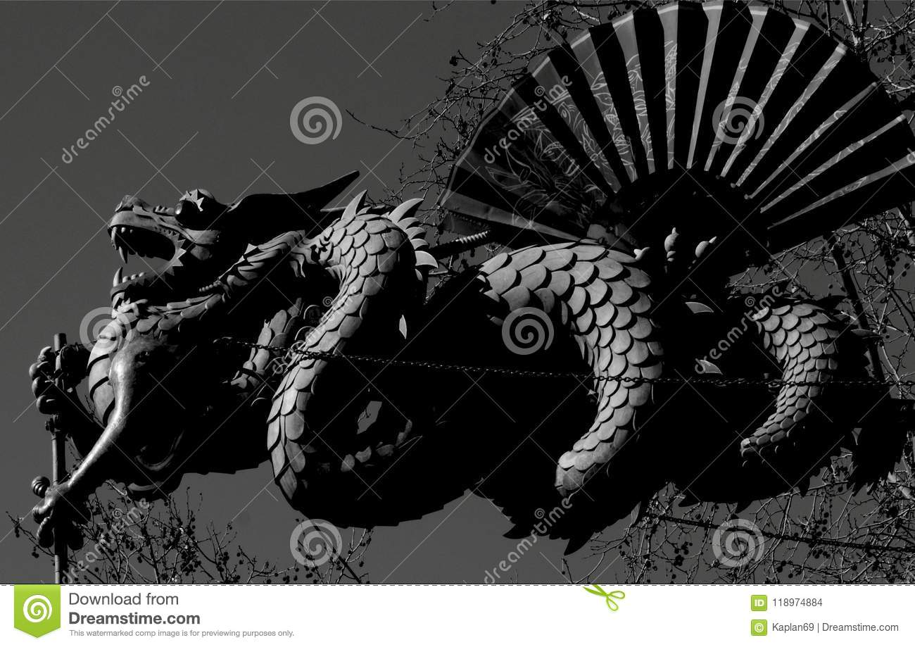 Chinese Dragon With The Big Fan Stock Photo - Image of shield