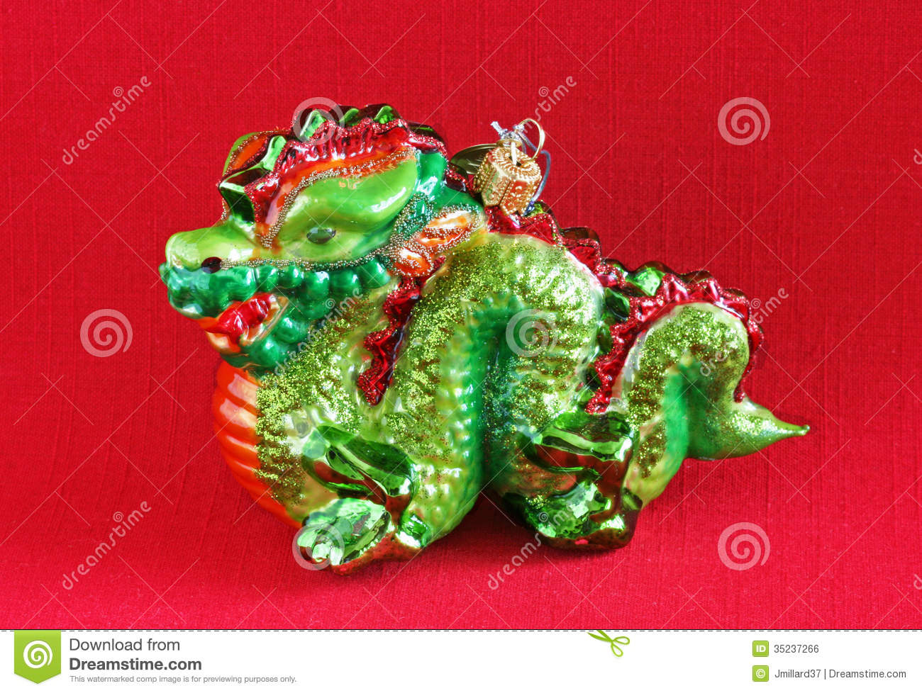 green dragon christmas ornament on red background