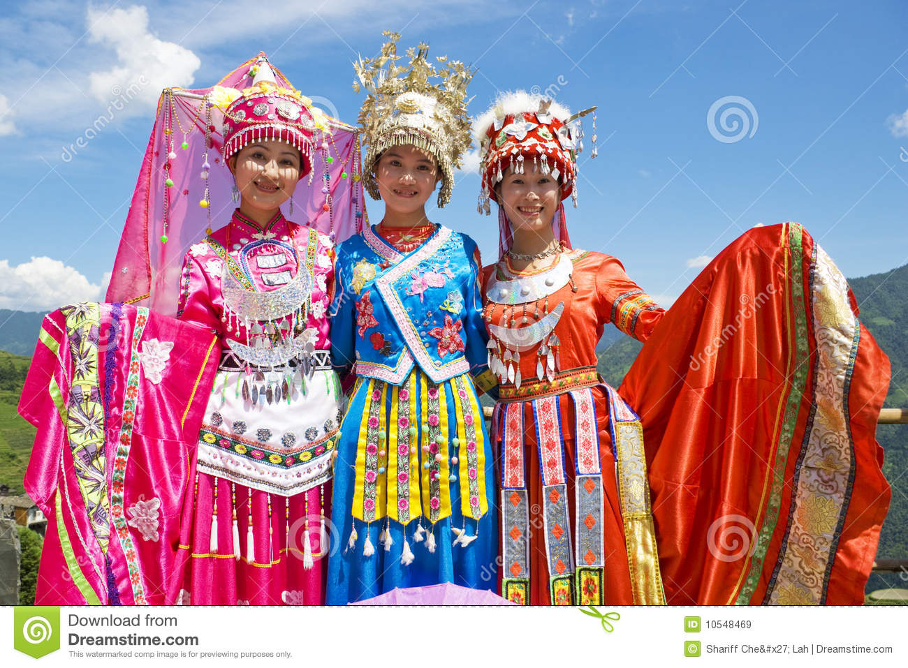 chinese ethnic girls in traditional dress editorial stock