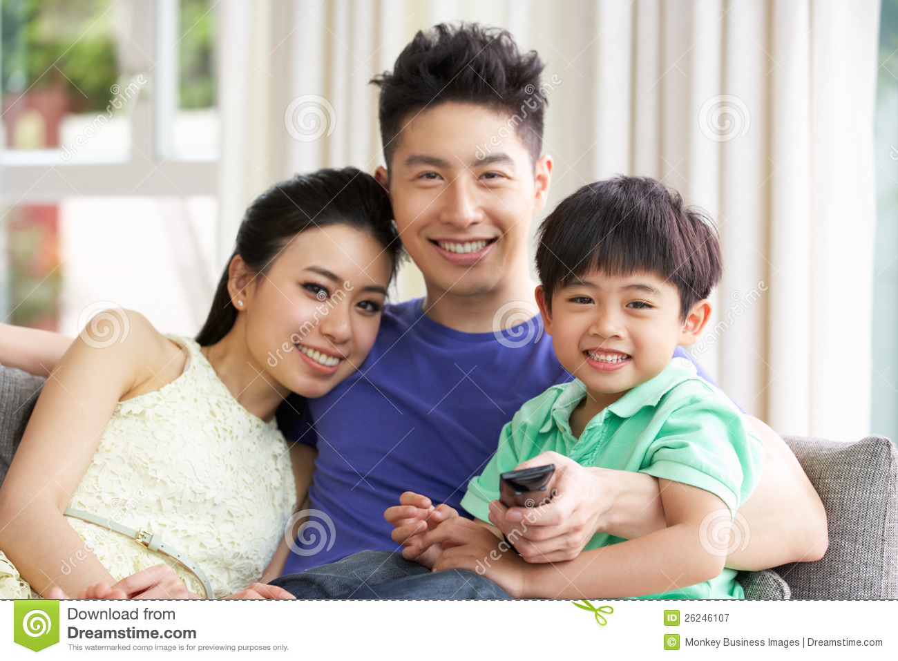 Royalty Free Stock Photography: Chinese Family Watching TV On Sofa ...