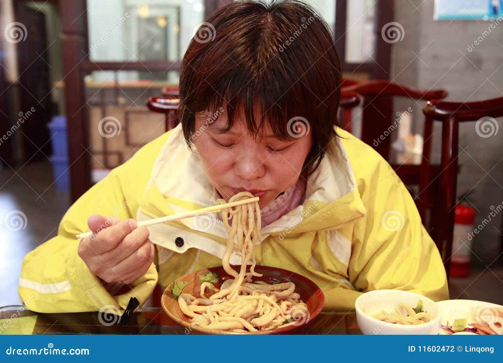 Chinese Female Eating Noodles Stock Photography Image