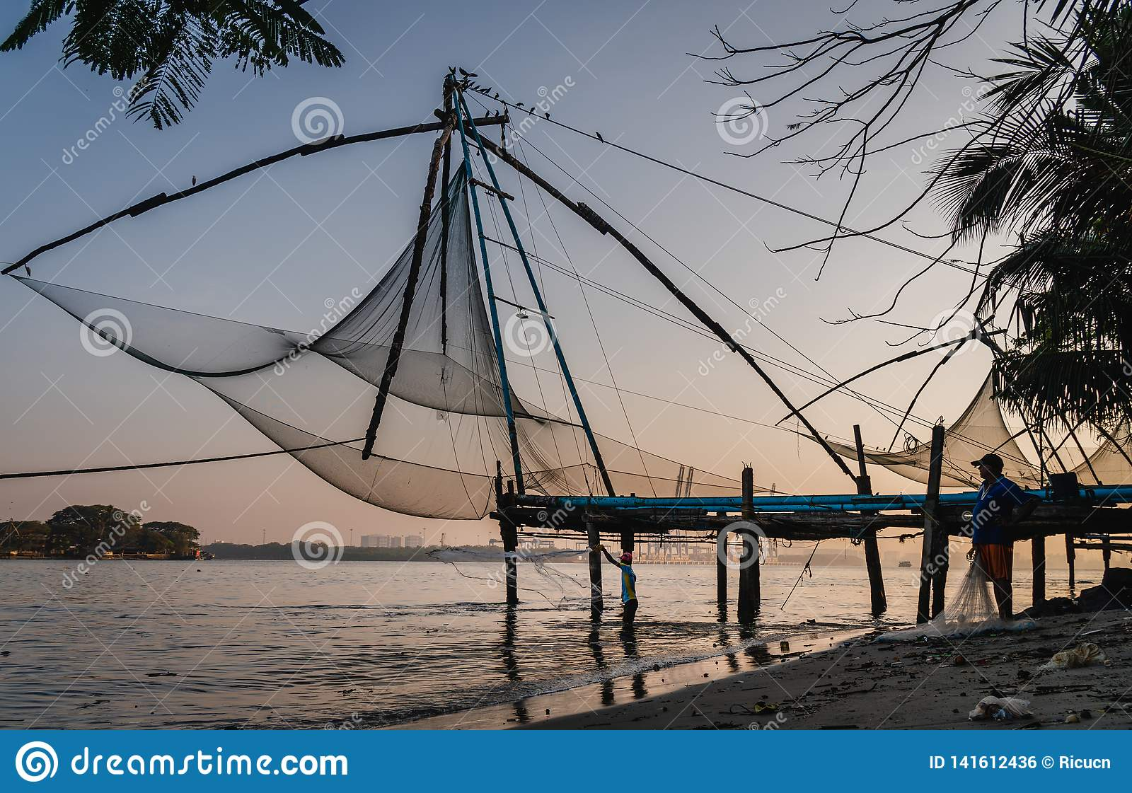 Chinese fishing nets during the Golden Hours at Fort Kochi, Kerala, India sunrise fisherman work