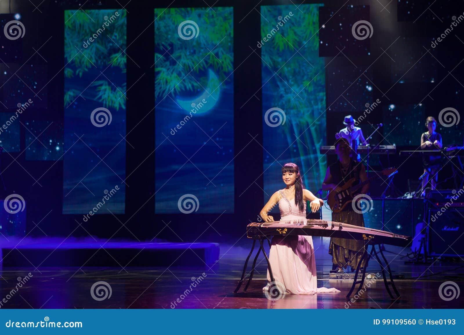 Chinese folk music performer playing Guzheng