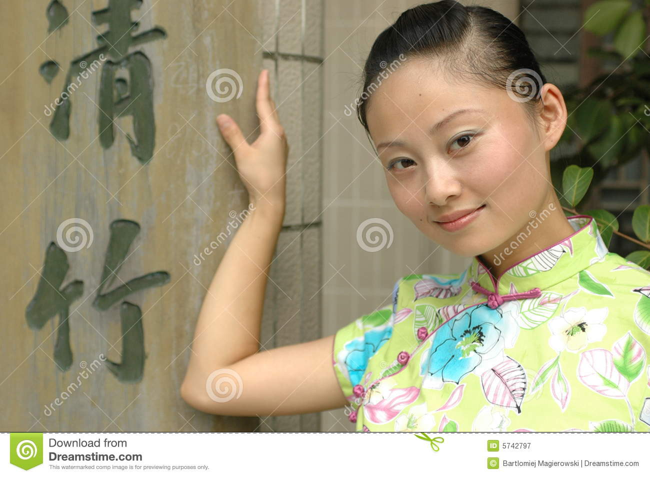 Chinese girl with Chinese signs
