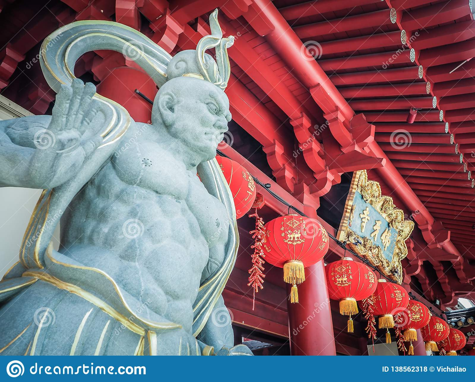 Chinese God stone statue in front of Buddha Tooth Relic Temple