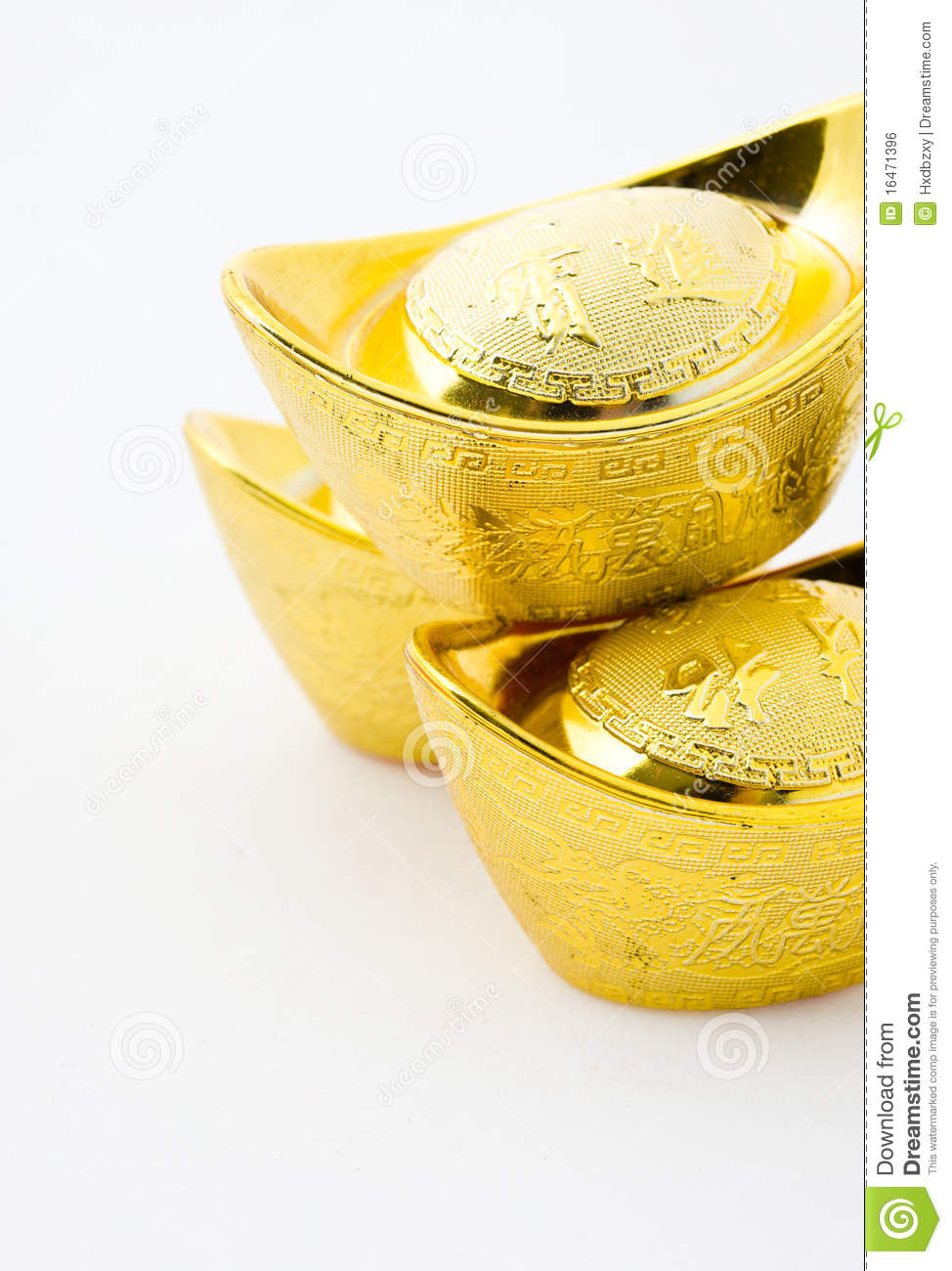 Chinese gold ingot ornaments isolated on white background. The ...