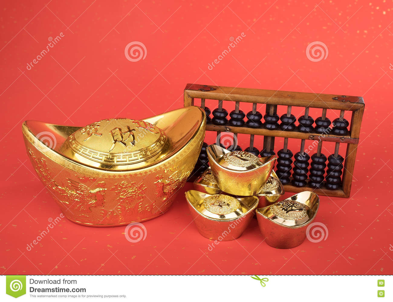 Chinese gold ingot and abacus mean symbols of wealth