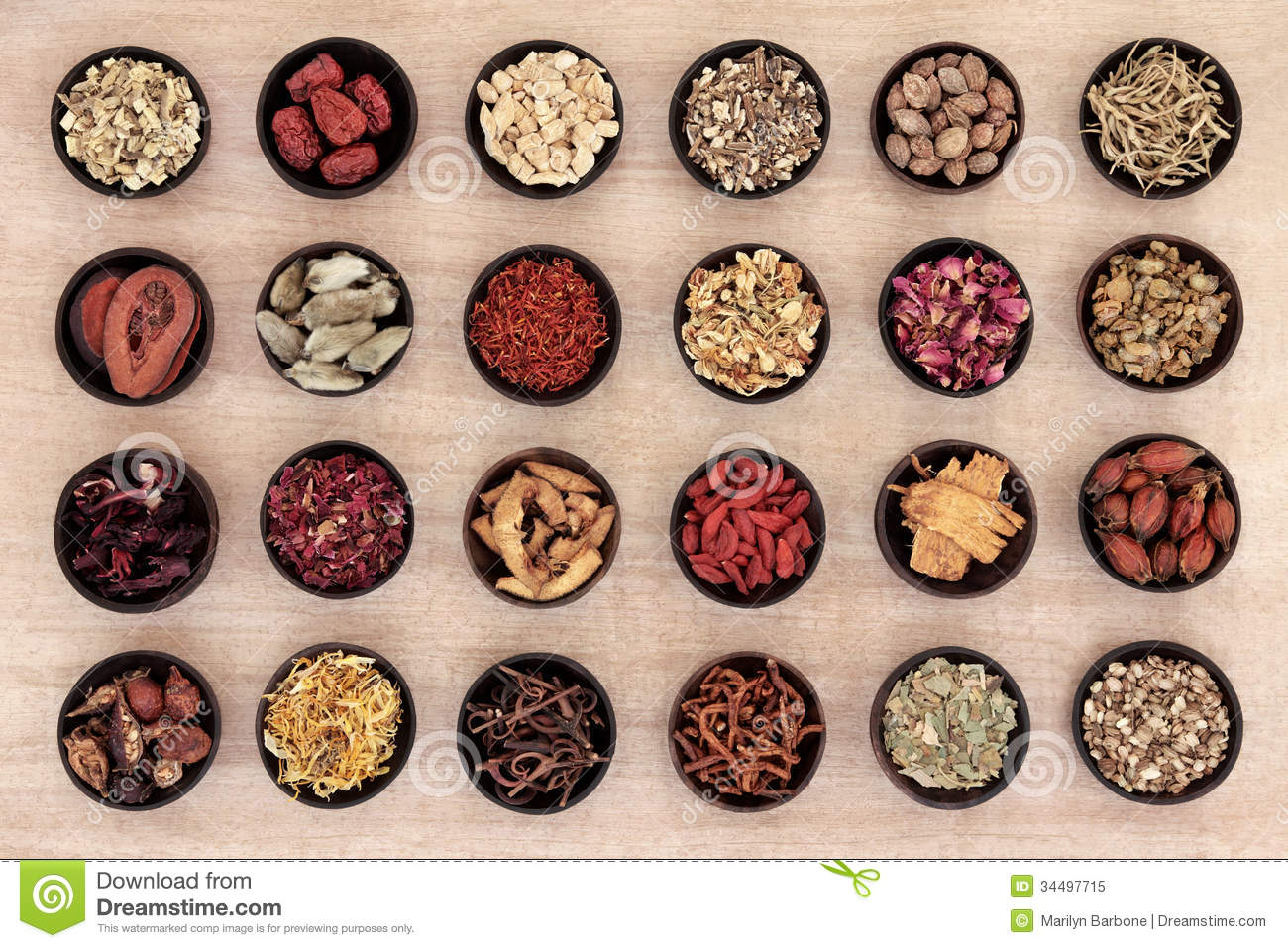 Traditional chinese herbal medicine in wooden bowls over papyrus ...