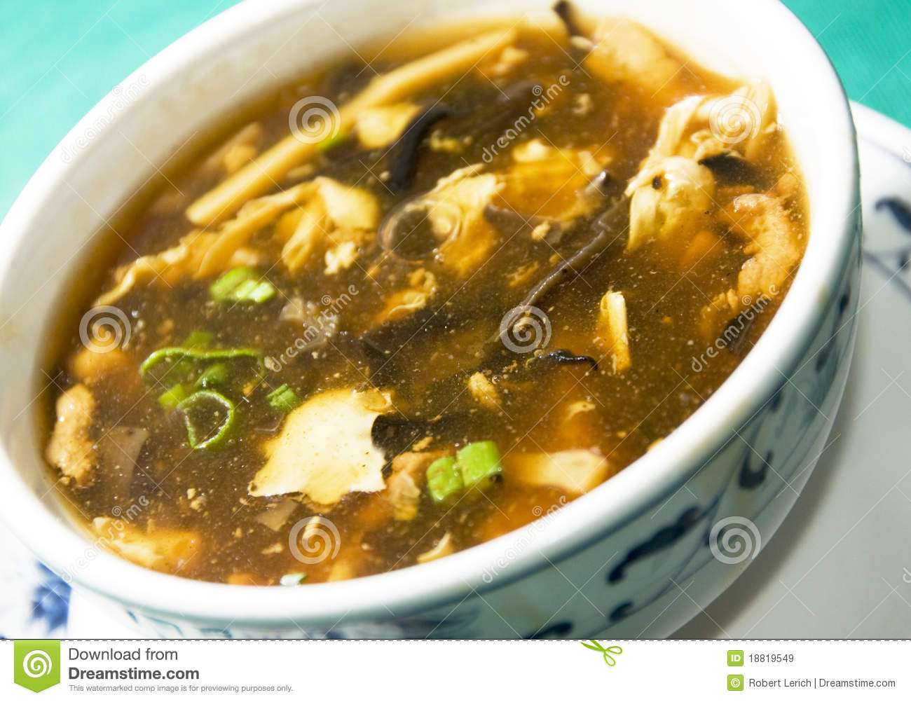 Chinese hot and sour soup vegetables scallions tofu spicy soup.