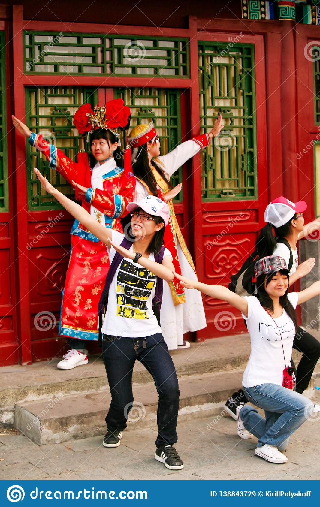 Beijing China - June 7, 2018: Chinese tourists in national costumes are photographed at the pavilion in the Forbidden City.