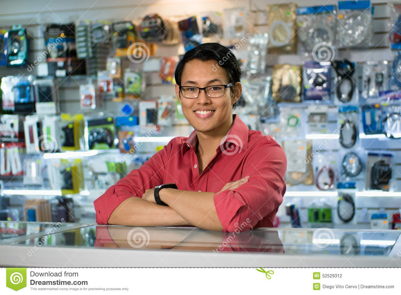 chinese man working as clerk assistant in computer shop stock chinese man working as clerk assistant in computer shop