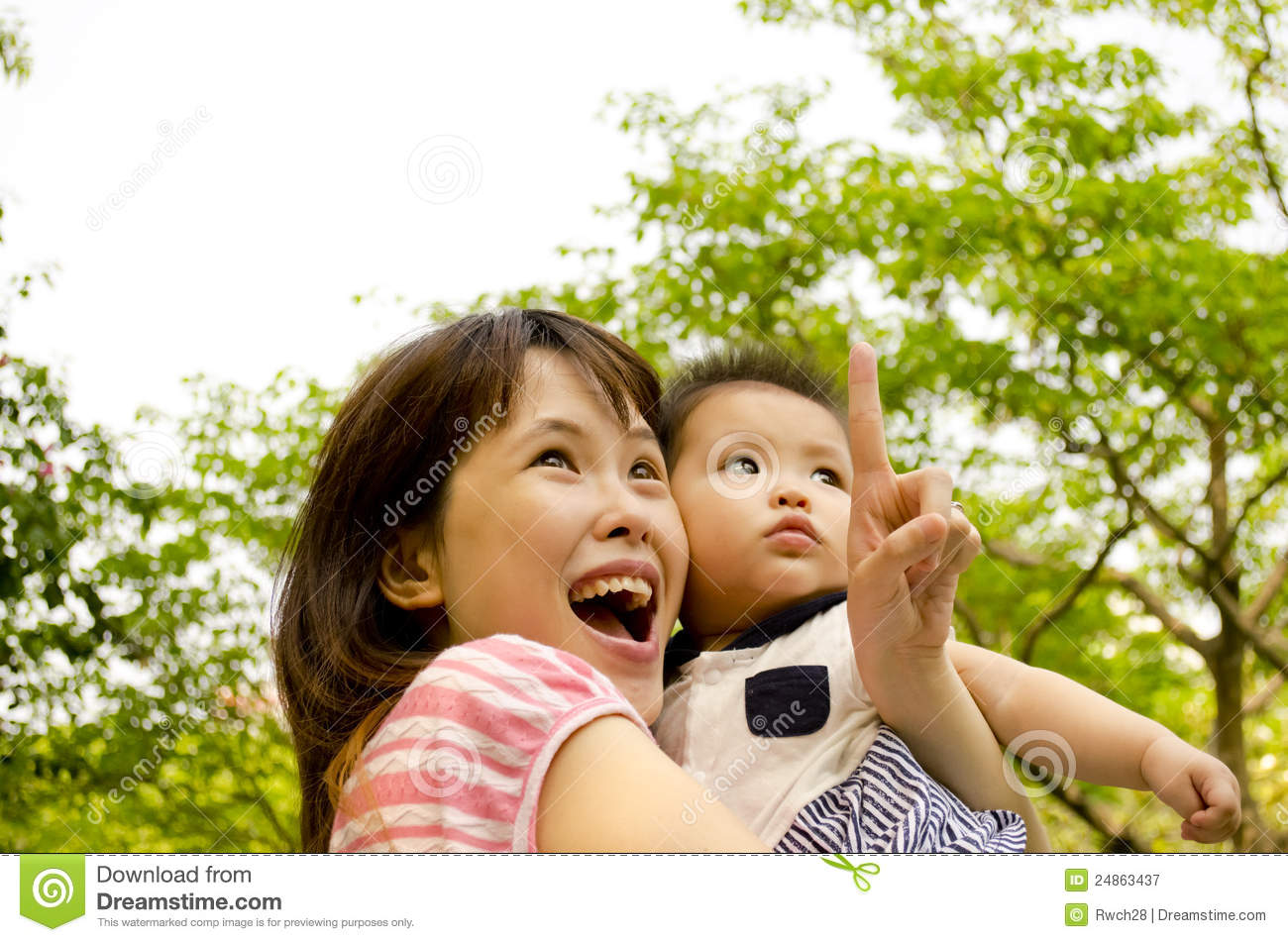 Chinese Mother And Baby Looking Up Royalty Free Stock