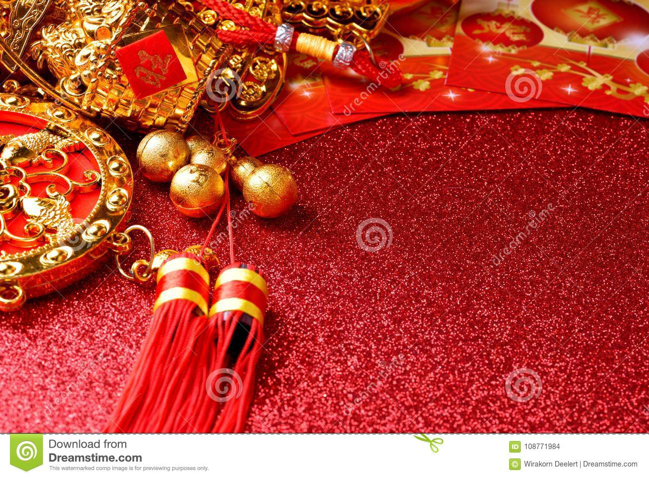 chinese new year decorations and auspicious ornaments on red bokeh background