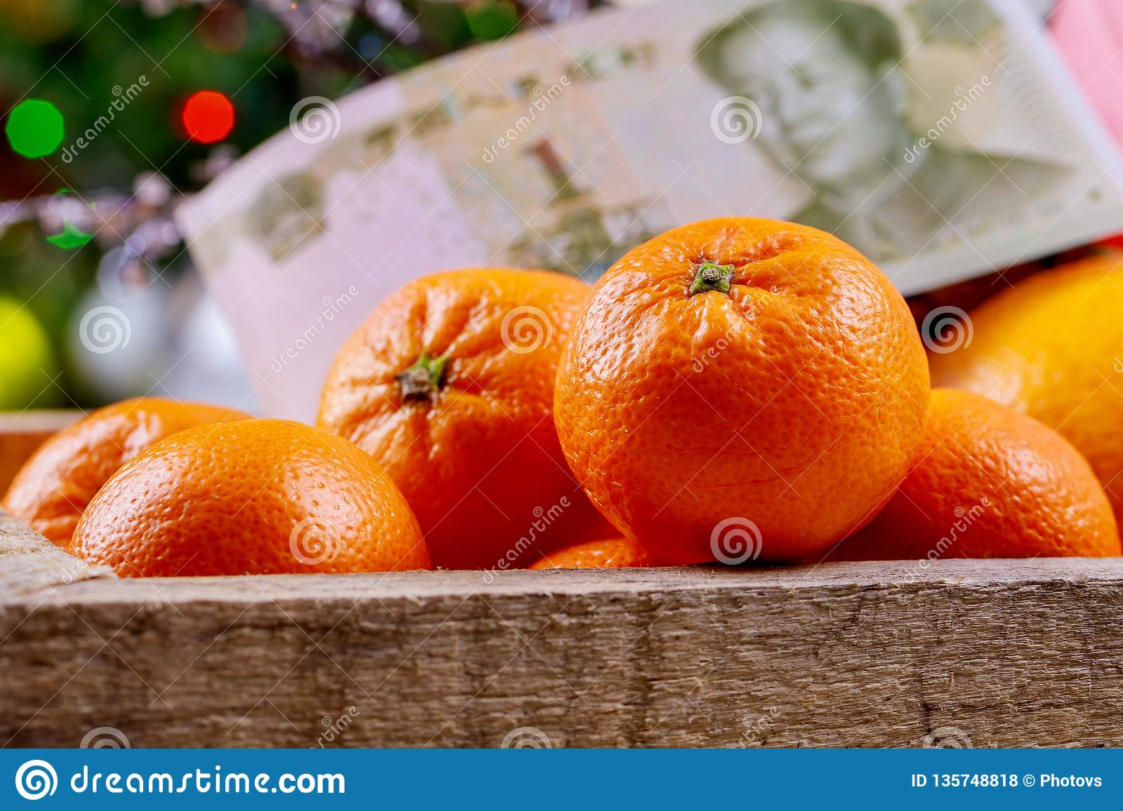 Chinese new year festival decorations orange wood basket Chinese yuan banknotes