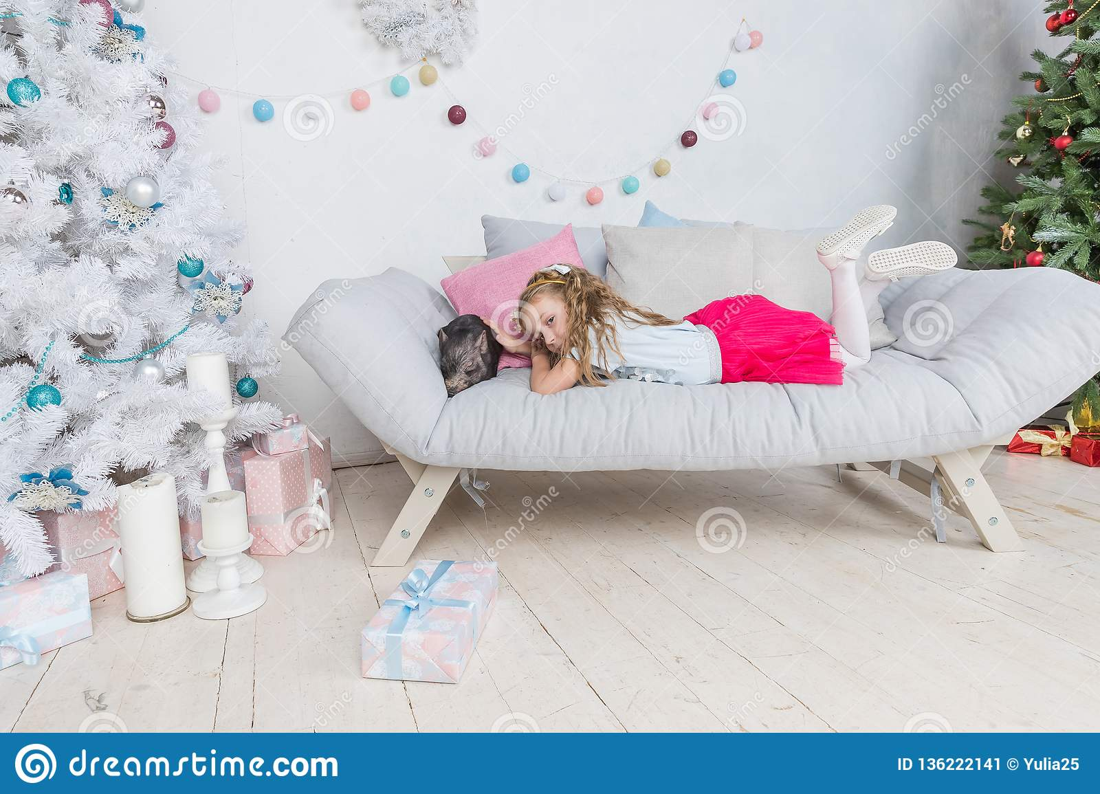 Chinese New Year 2019. Lucky Pig. The year of the pig. Cute blonde girl with baby pig celebrating Chinese New Year. 2019