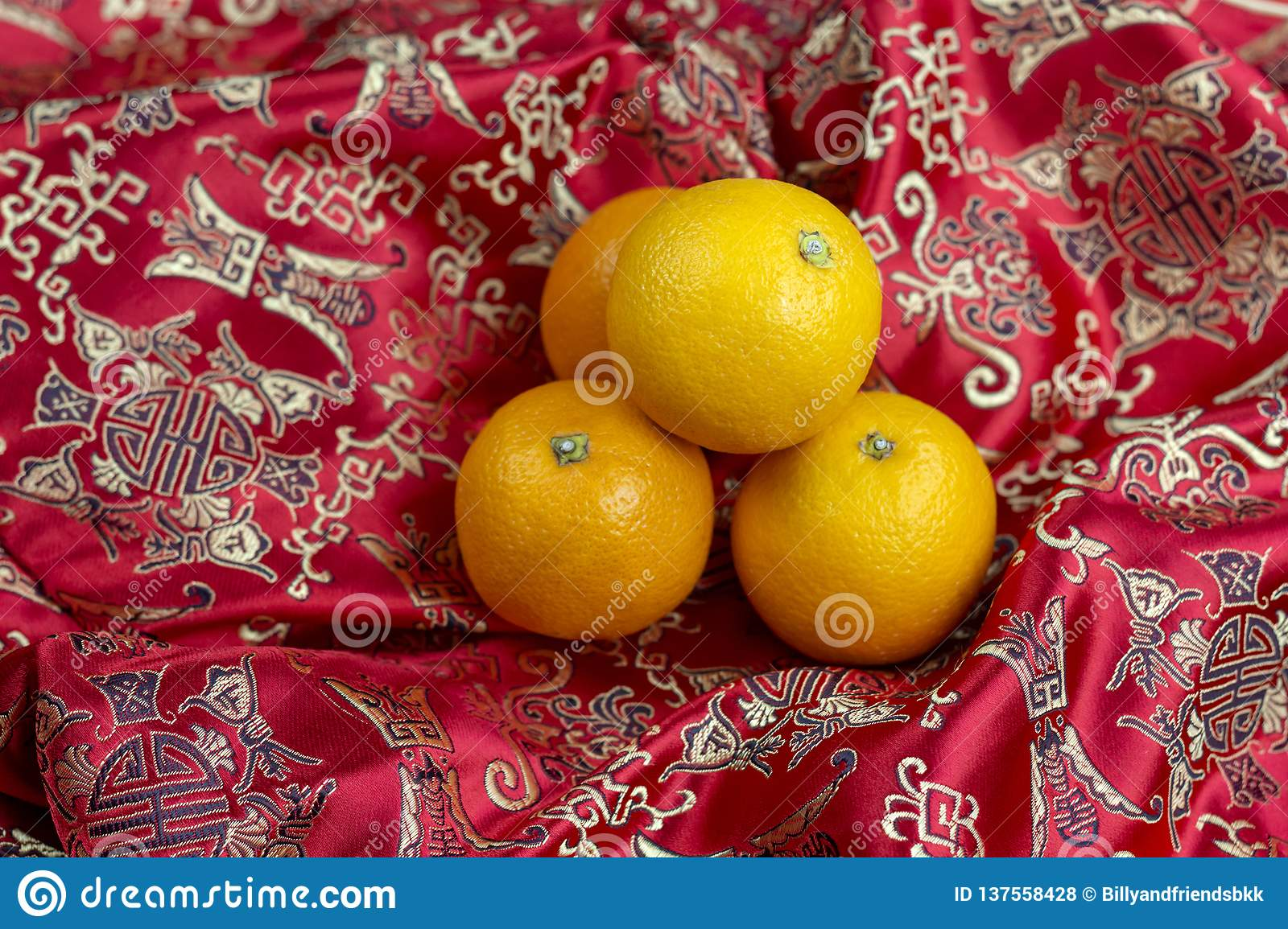 Chinese new year oranges on red Chinese textile background