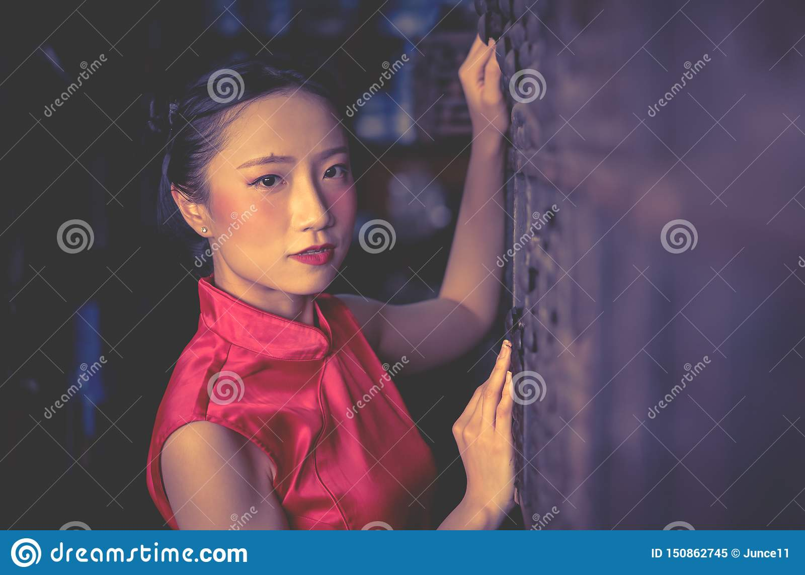 Chinese seller worker in a steel metal store shop